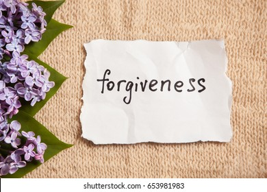 Forgiveness word on beautiful background with flowers