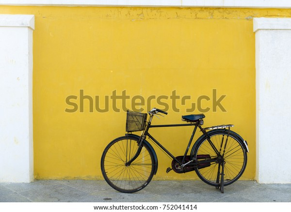 A forgotten old bicycle leaning against a wall in the beautiful town of Pondicherry, India.