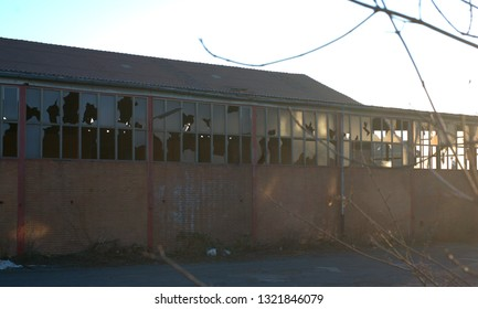 forgotten old warehouse with broken windows, lost places