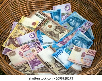 Forint. Hungarian Forint banknotes in wicker basket.
