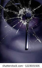 Fork with broken glass, mystery, rupture.