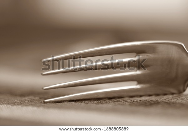 Fork isolated background in sepia