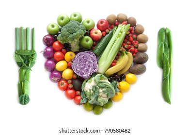 Fork and knife made from vegetables with heart shape fruits and vegetables as a meal