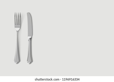 Fork and knife mockup. Stainless steel, silver kitchenware, flatware. Isolated  on a white background ready for your design.