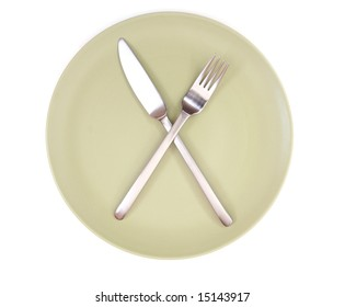 fork and knife on green plate