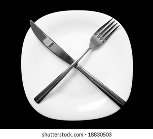 Fork and knife on plate.