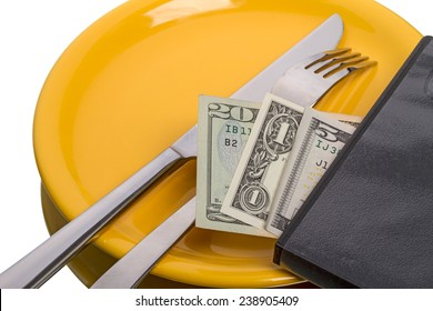 Fork, knife on yellow plate and and dollars isolated on white background