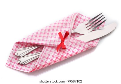 Fork and knife in a plaid cloth with a bow  isolated on white