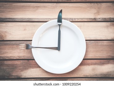 Fork with knife and plate on the table. Time to eat.