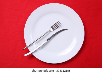 fork and knife with red background