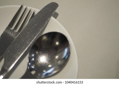 Fork Knife Spoon Dish on the table close up in left of photo. This is useful for dinner card design or restaurant's menu and photo in kitchen. This photo have space on right for text.