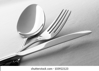 Fork, knife and spoon on the table