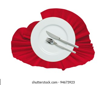 Fork, knife and white plate on a red cloth isolated on white