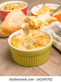 A fork lifting fresh Dungeness Crab macaroni and cheese