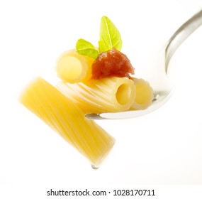 fork with macaroni tomato sauce and basil