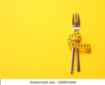 Fork with a measuring tape, diet or healthy eating concept