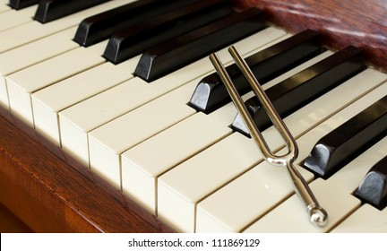 Fork on a piano keyboard