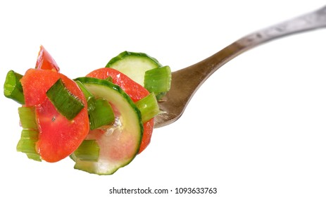 Fork with salad vegetables from tomato and cucumber isolated on a white background