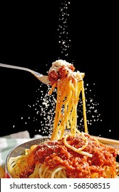 Fork with spaghetti and parmesan cheese. (Movement action for designed work)