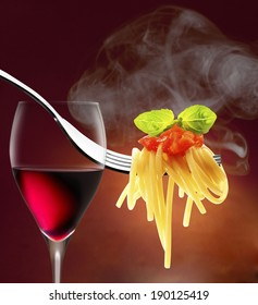 Fork with spaghetti tomato  basil ans red wine