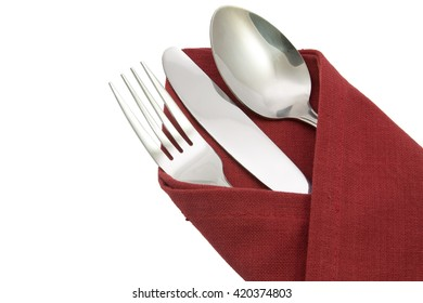 fork spoon and knife on red napkin isolated on white background.