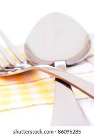 Fork and spoon on a napkin