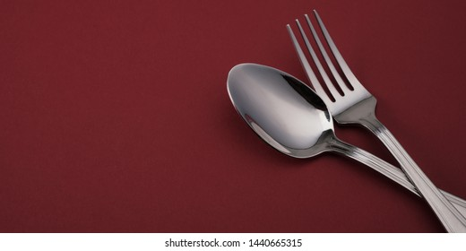Fork and spoon on red background, banner concept