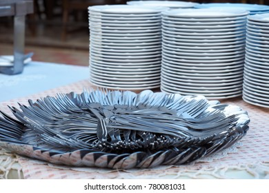 Fork and spoon setting for outdoor party on the table