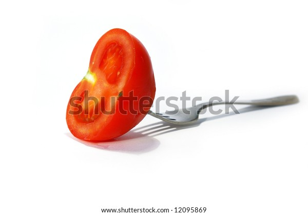 Fork and tomato isolated on a white background