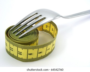 Fork with yellow measuring tape - Healthy life concept