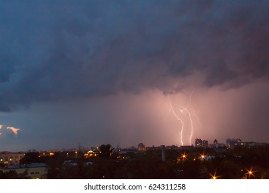 Forked lightning over skyline in night sky background. Moscow, Russia.