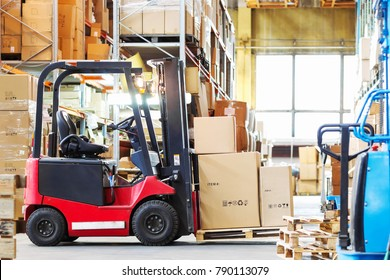 forklif  with a three large cardboard boxes in a modern warehous