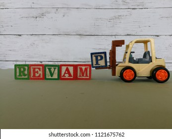 Forklift carry letter P to complete the revamp word