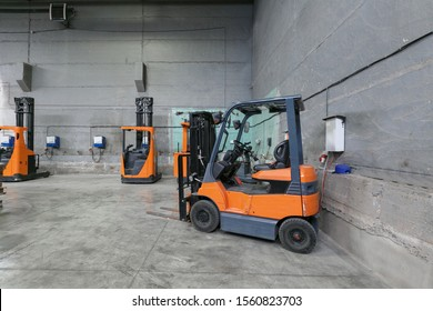 forklift charging in the warehouse