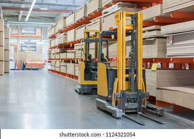 forklift in a construction shop. Construction Materials. Stacking truck in wholesale warehouse