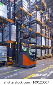 Forklift in distribution centre warehouse