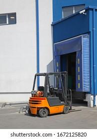 Forklift at Distribution Warehouse Loading Dock