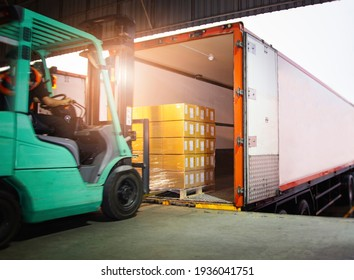 Forklift Driver Loading Package Boxes into Cargo Container. TrailerTruck Parked Loading at Dock Warehouse. Shipment Delivery Service. Shipping Warehouse Logistics. Freight Truck Transportation.