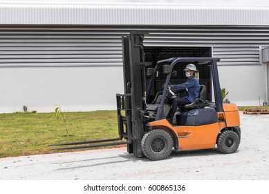 Forklift driver images stock photos vectors shutterstock forklift driver in protective vest driving forklift at warehouse of freight forwarding company publicscrutiny Image collections