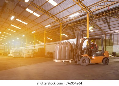Forklift driver standing proud in manufacturing plant of industry