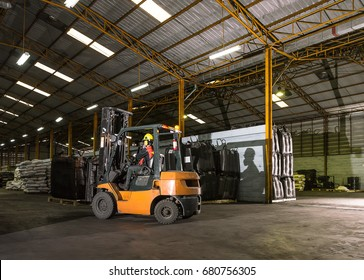 Forklift driver standing proud in manufacturing plant