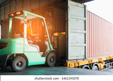 forklift driver unloading cargo shipment into a truck trailer.