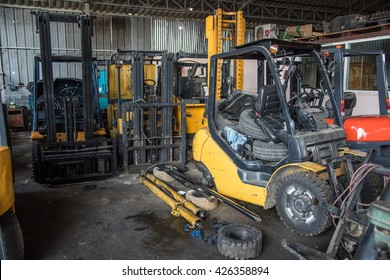 Forklift garage with parts