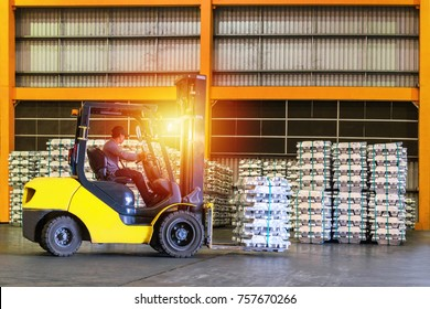 Forklift handling Aluminum Ingot by an operator for stuffing into container for export.