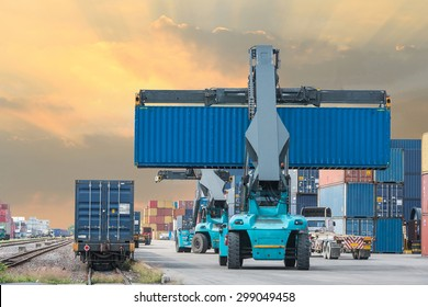 Forklift handling container box loading to freight train in import and export area at port.