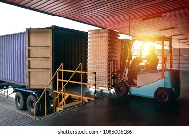 Forklift handling empty tin cans from container into warehouse. Distribution, Logistics Import Export, Warehouse operation, Trading, Shipment, Delivery concept.
