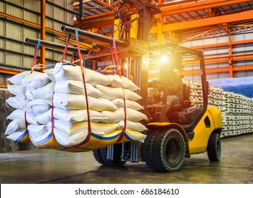 Forklift handling sugar bag for stuffing into container for export. Distribution, Logistics Import Export, Warehouse operation, Trading, Shipment, Delivery concept.