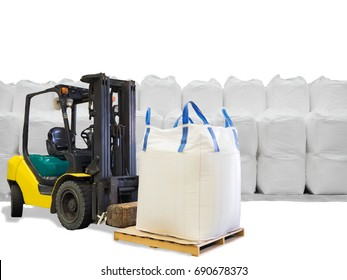 Forklift handling the sugar in jumbo bags on pallet from stacking in warehouse, isolated on white background