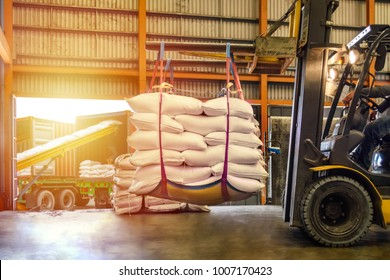 Forklift handling white sugar bags for stuffing into containers outside a warehouse. Distribution, Logistics Import Export, Warehouse operation, Trading, Shipment, Delivery concept.