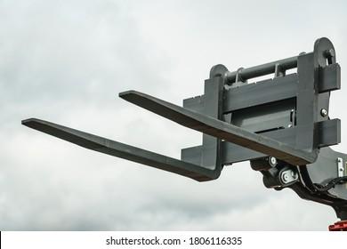 Forklift industrial loader or stacker against sky. Part of agricultural machine. Telescopic handler.